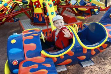 Kid in plane on carousel
