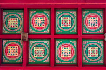 Colorful pattern on ceiling of Buddhist temple