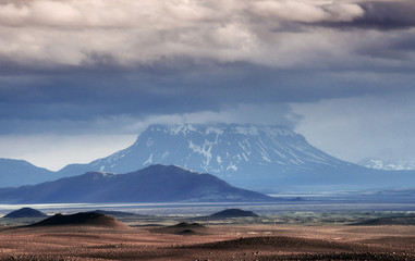Beautiful landscape of mountain in Iceland with volcano in the background
