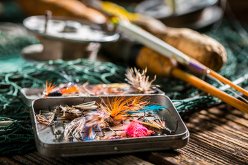 Closeup of handmade angler equipment with rods and fishing flies