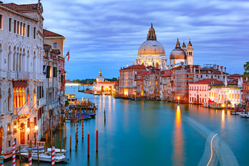Grand canal and The Basilica of St Mary of Health or Basilica di Santa Maria della Salute at night in Venice, Italy