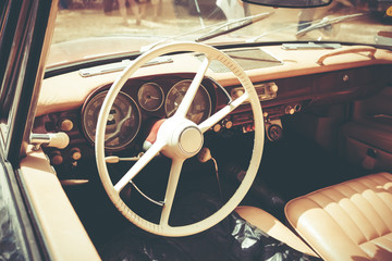 ISRAEL, PETAH TIQWA - MAY 14, 2016: Steering wheel and dashboard in interior of old retro automobile in Petah Tiqwa, Israel.