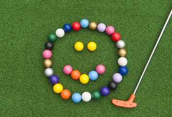 Golf Ball Happy Face with Putter