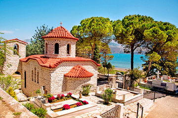 Beautiful landscape with an ancient church at the cemetery near the sea in Argostoli, Kefalonia, Greece.  Stunning amazing charming places. prominent tourist towns.