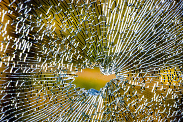 broken tempered glass closeup , background of glass was smashed close up