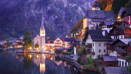 Classic postcard view of famous Hallstatt lakeside town reflecting in Hallstattersee lake in the Austrian Alps