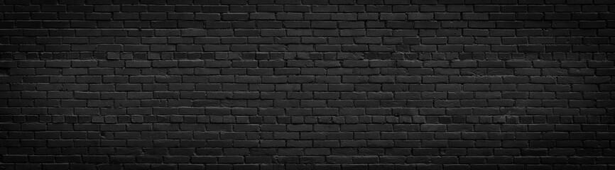 Old black brick wall panorama