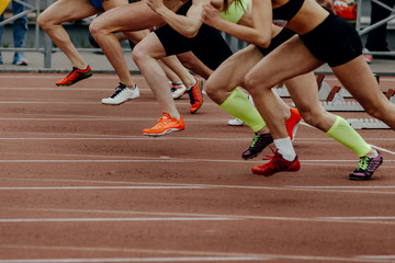 women feet runners sprinters start and run at 100 meters