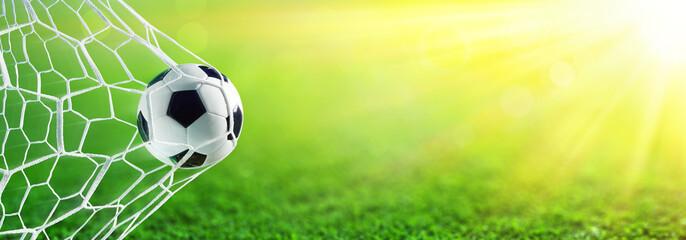 Soccer Ball In Goal With Sunlight