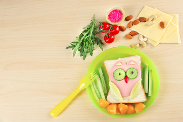 Creative breakfast for children on plate. Recipe ideas with bread