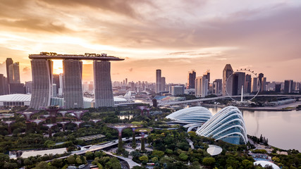 Aerial drone view of Singapore city skyline at sunset