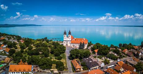 Tihany, Hungary - Aerial panoramic view of the famous Benedictine Monastery of Tihany (Tihany Abbey) with beautiful coloruful Lake Balaton at background