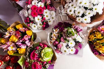 A lot of colorful flower bouquets , florist business.