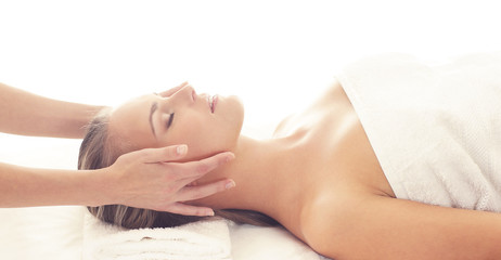 Beautiful Woman in Spa. Recreation, Energy, Health, Massage and Healing Concept.