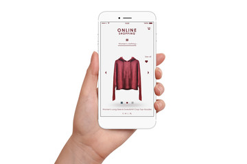 Female hand holding smartphone and shopping online, isolated on white background. Online shopping concept