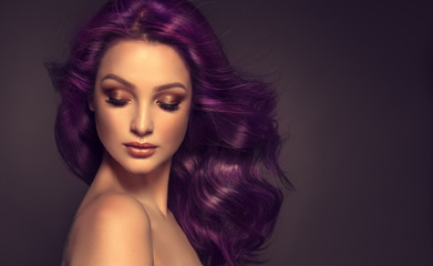 Beautiful model girl with long purple curly hair . Care products ,hair colouring .  Treatment, care and spa procedures. Medium length hairstyle. Coloring, ombre,  and highlighting . Hair coloring