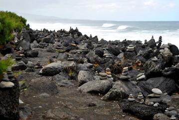 Reunion island seascape, landscape. Black sand, volcanic rocks.