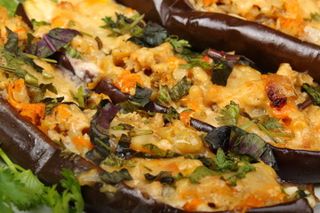 Stuffed eggplant with meat and vegetables with cheese, baked in the oven