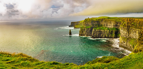 Beautifull wild landscape of Cliffs of Moher in Ireland. Hiking trip on summer holidays.