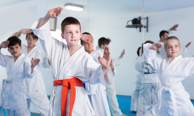 Children training new moves during karate class
