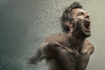 Screaming frustrated man dispersing and disintegrating into particles, agonizing and torturing expression