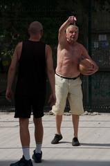 Senior man playing basketball.