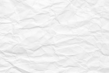Tło jest białe. Tekstura papieru z załamaniami i wgnieceniami, stara i zniszczona.