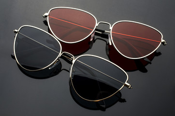 sunglasses cat's eye in metal frame isolated on black