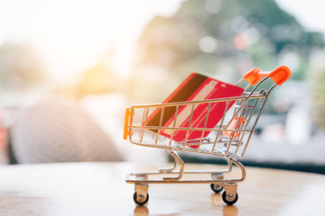 Credit card in small cart with shopping online concept.