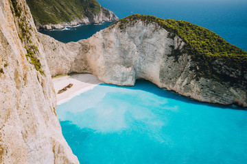 Navagio beach or Shipwreck bay with turquoise water and pebble white beach. Famous landmark location. overhead landscape of Zakynthos island, Greece
