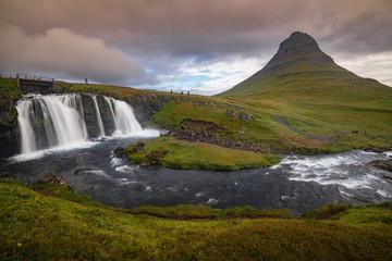 Kirkjufellfoss and Kirkjufell mountain in cloudy day ,Iceland.