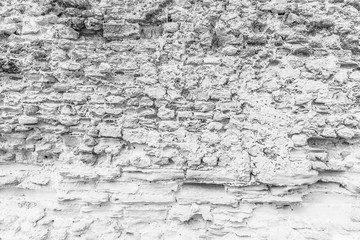 Background of ancient  stone wall. Texture of old brick.