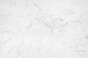 Cracked paint on a white wall texture