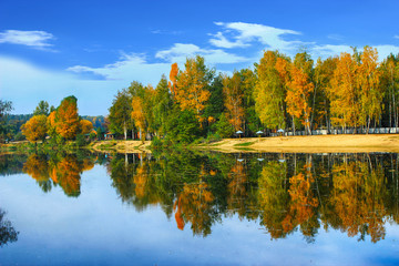 Reflection in the water. Sunny autumn bright landscape