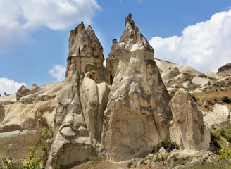 Stone houses in the ancient rocks of Goreme, Cappadocia, Turkey. Rural way of life.