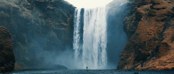 Woman overlooking waterfall at skogafoss, Iceland. Skógafoss, Ísland.