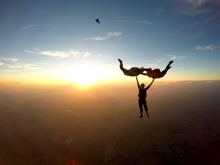 Skydivers having fun at the amazing sunset
