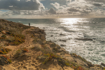 Walking girl by Atlantic ocean coast, hiking, sport, Portugal
