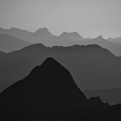 Silhouettes of Mount Tannhorn and other mountains in the Bernese Oberland. View from Mount Brienzer Rothorn.