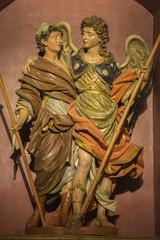 ZARAGOZA, SPAIN - MARCH 3, 2018: The polychome carved baroque satatue of Raphael archangel with the Tobias in church  Iglesia de San Miguel de los Navarros.