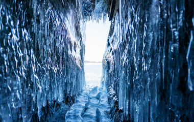 Winter Landscape, Frozen ice cave with bright sunlight from way out at lake Baikal in Irkutsk, Siberia, Russia