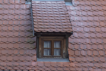 Roof with attic, covered with red tiles