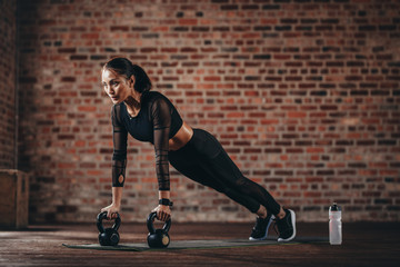 Woman working out at cross training gym