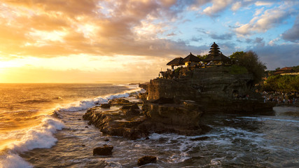 Tanah Lot in sunrise colors,the most famous temple at Bali island,Indonesia