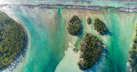 small islands (motu) in the middle of a lagoon in aerial view, French Polynesia