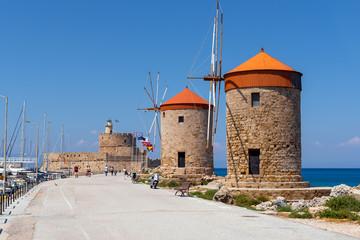 The historic windmills at the Mandraki harbor in Rhodes town. Rhodes Island, Greece