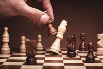 Businessman playing chess close up