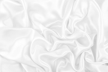 Luxurious of smooth white silk or satin fabric texture background