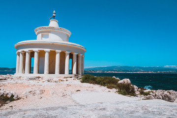 Lighthouse of St. Theodore at Argostoli against clear blu sky. Kefalonia island. Greece