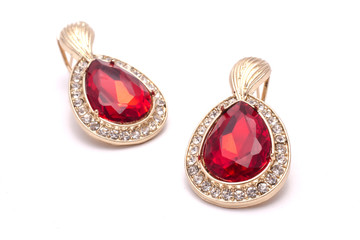 gold earrings with ruby drops isolated on white